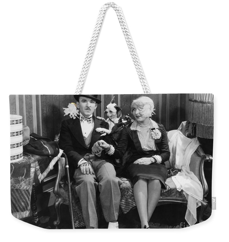-ec33- Weekender Tote Bag featuring the photograph Silent Still: Man & Animal by Granger
