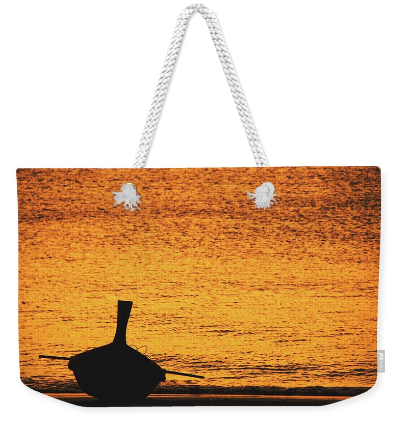 Background Weekender Tote Bag featuring the photograph Silhouette Of A Thai Wooden Boat On The Beach Against Golden Sunset Koh Lanta, Thailand by Srdjan Kirtic