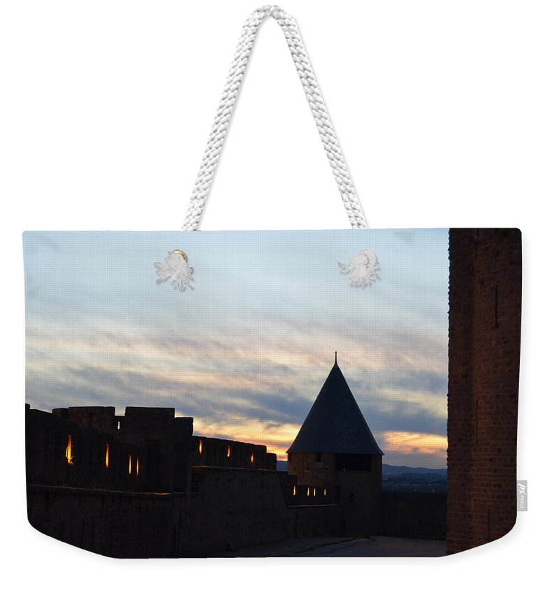 Silhouetted Weekender Tote Bag featuring the photograph Silhouetted Castle by Dawn Crichton