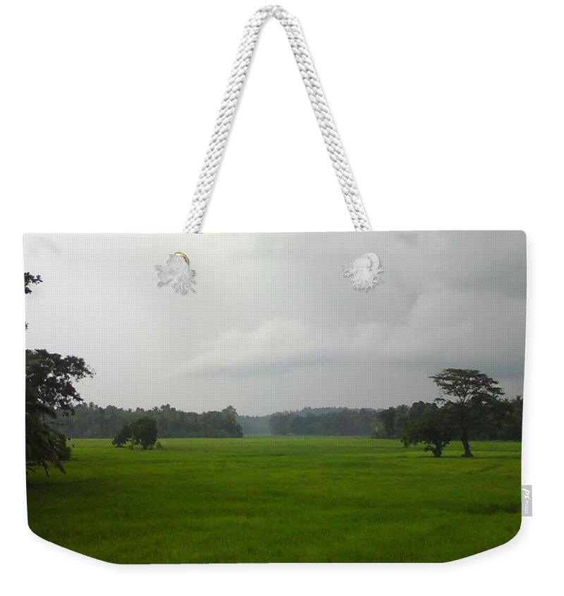 Photo Weekender Tote Bag featuring the photograph Simple Green by Rushan Ruzaick