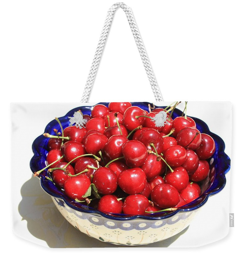 Cherries Weekender Tote Bag featuring the photograph Simply A Bowl Of Cherries by Carol Groenen