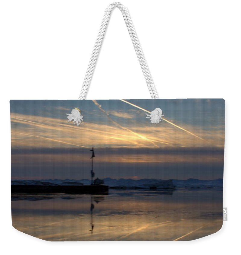 Grand Bend Weekender Tote Bag featuring the photograph Skating On The Sky 3 by John Scatcherd