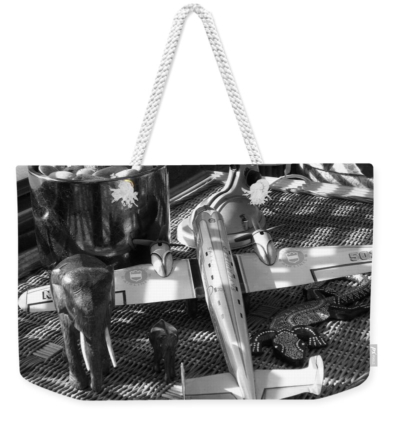 Still Life Weekender Tote Bag featuring the photograph Skycruiser by Charles Stuart