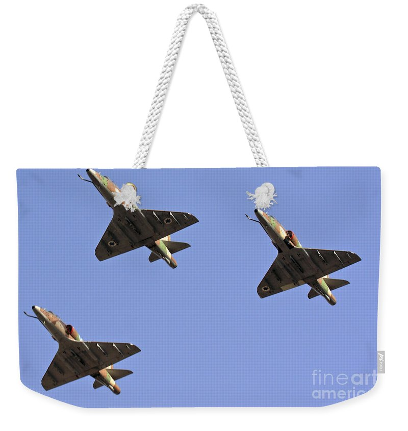 Aircraft Weekender Tote Bag featuring the photograph Skyhawk Fighter Jet In Formation by Nir Ben-Yosef