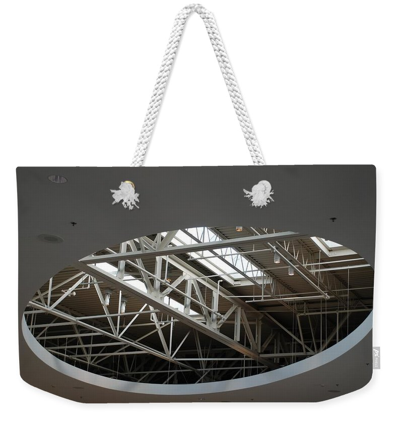 Ceiling Weekender Tote Bag featuring the photograph Skylight Gurders by Rob Hans