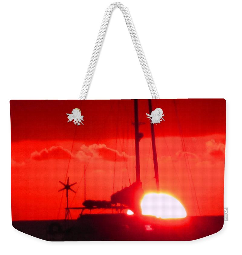 Sunset Weekender Tote Bag featuring the photograph Slipping Over The Edge by Ian MacDonald
