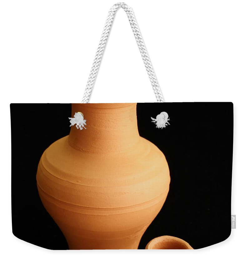 Ceramics Weekender Tote Bag featuring the photograph Small Pottery Items by Gaspar Avila
