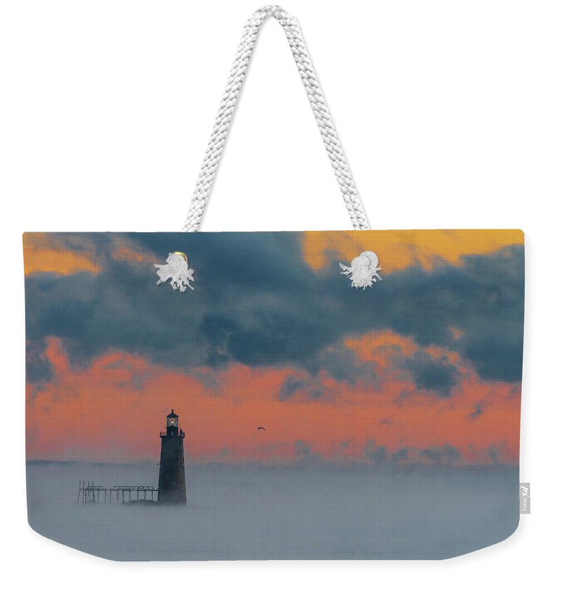 Maine Weekender Tote Bag featuring the photograph Smokey Sunrise At Ram Island Ledge Light by Jesse MacDonald
