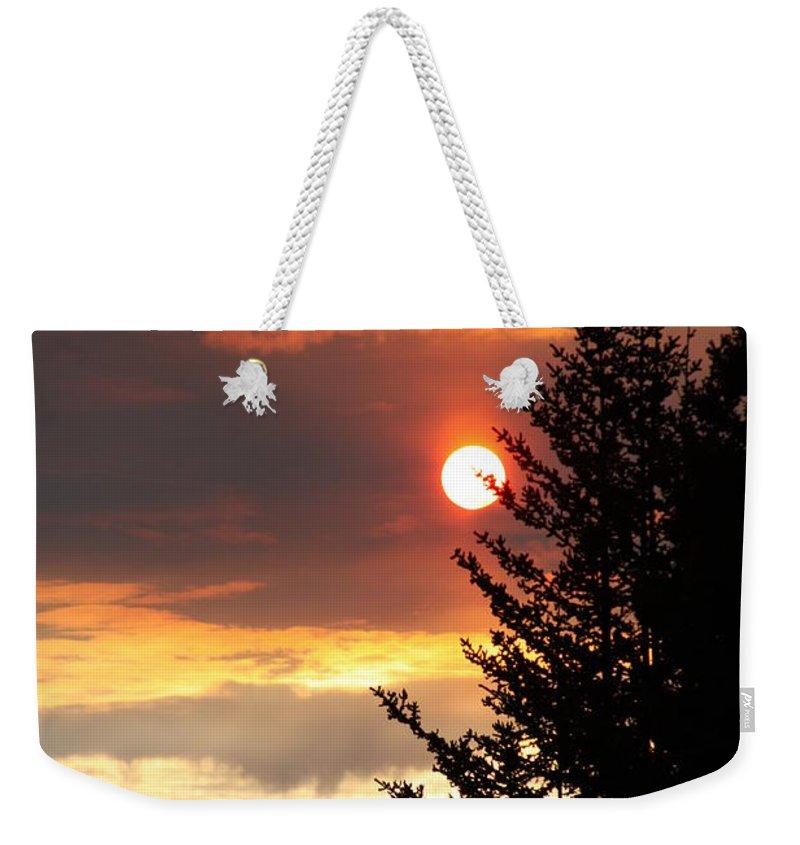 Smoky Sun Weekender Tote Bag featuring the photograph Smoky Sun by Lori Mahaffey