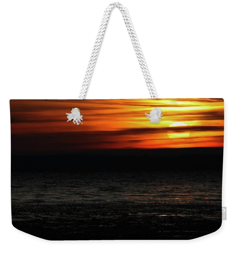 Sun Weekender Tote Bag featuring the photograph Smoky Sunrise by Dawn Braun