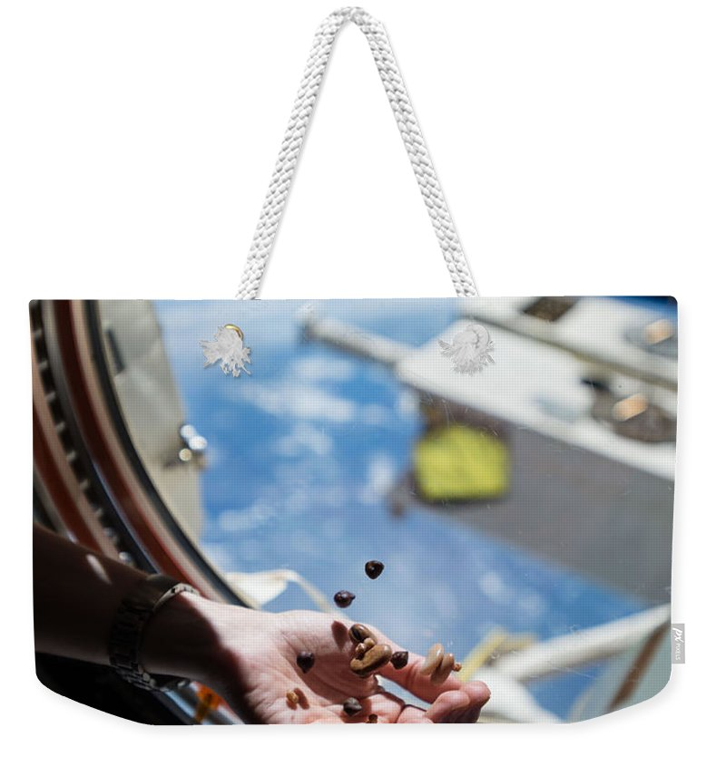 Satellite Weekender Tote Bag featuring the photograph Snacking In Space by Science Source