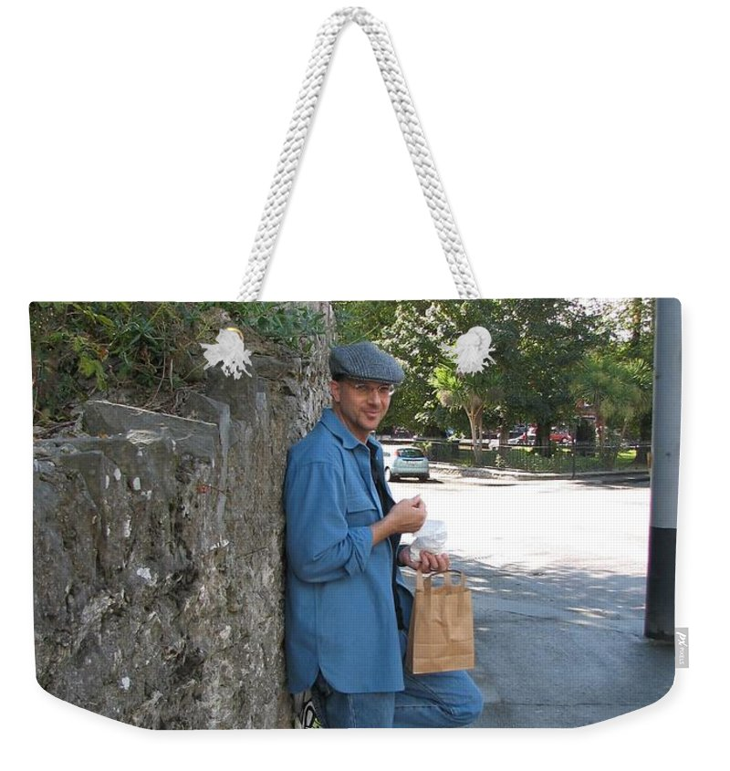 Hat Weekender Tote Bag featuring the photograph Sneaking A Snack by Kelly Mezzapelle