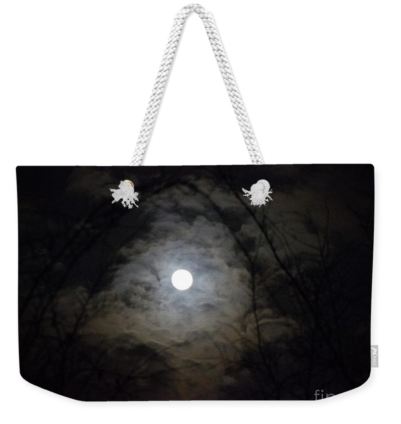 Snow Moon Weekender Tote Bag featuring the photograph Snow Moon by Rebecca Pavelka