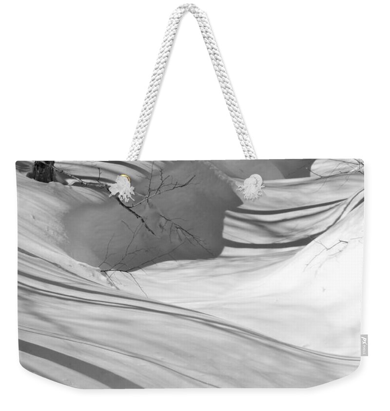 New England Weekender Tote Bag featuring the photograph Snow Swirls by Susan Russo