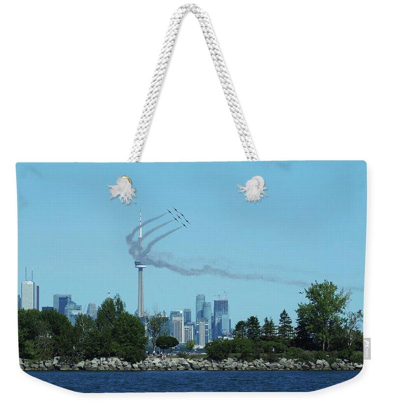 Toronto Weekender Tote Bag featuring the photograph Snowbirds Circle Cn Tower by BiR Fotos