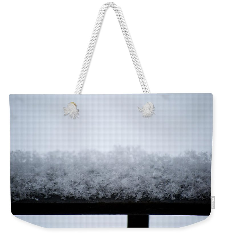 Iron Weekender Tote Bag featuring the photograph Snowflakes Chill The Iron by Lisa Knechtel