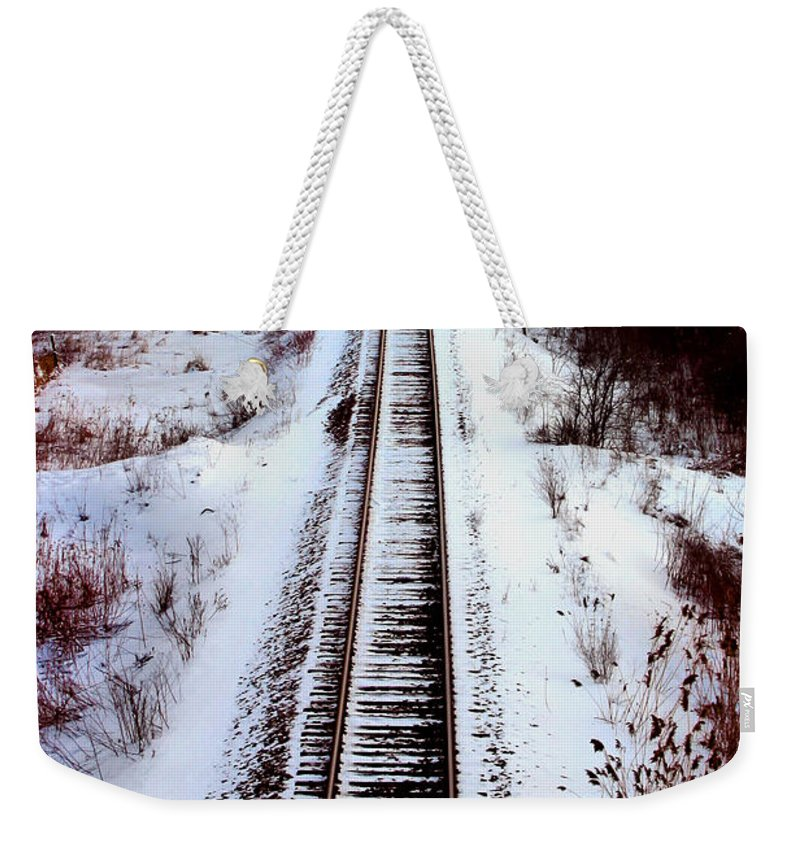 Train Tracks Weekender Tote Bag featuring the photograph Snowy Train Tracks by Anthony Jones