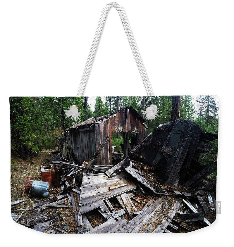 Dilapidated Weekender Tote Bag featuring the photograph Soap Creek Debris, Real Estate Series by Aaron James