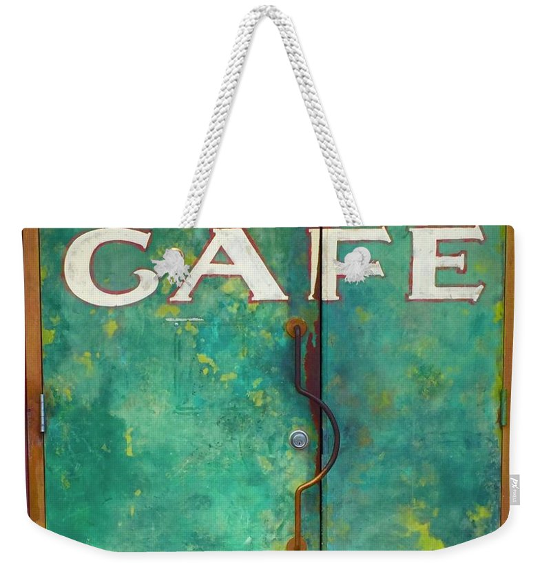 Weekender Tote Bag featuring the photograph Soco Cafe Doors by Cherylene Henderson