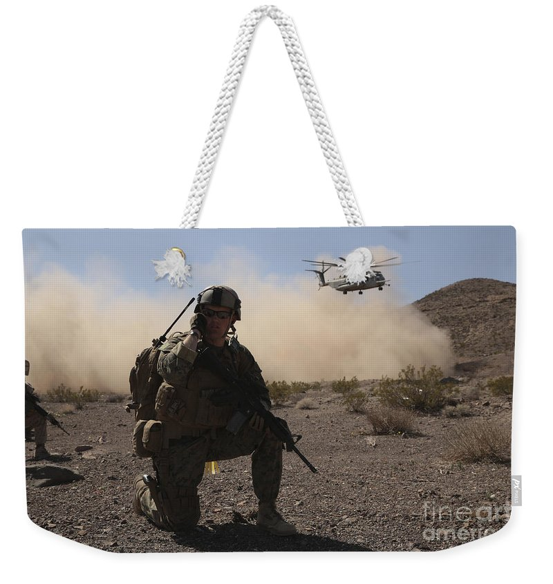 Combat Weekender Tote Bag featuring the photograph Solders Are Inserted By A Ch-53 Super by Stocktrek Images