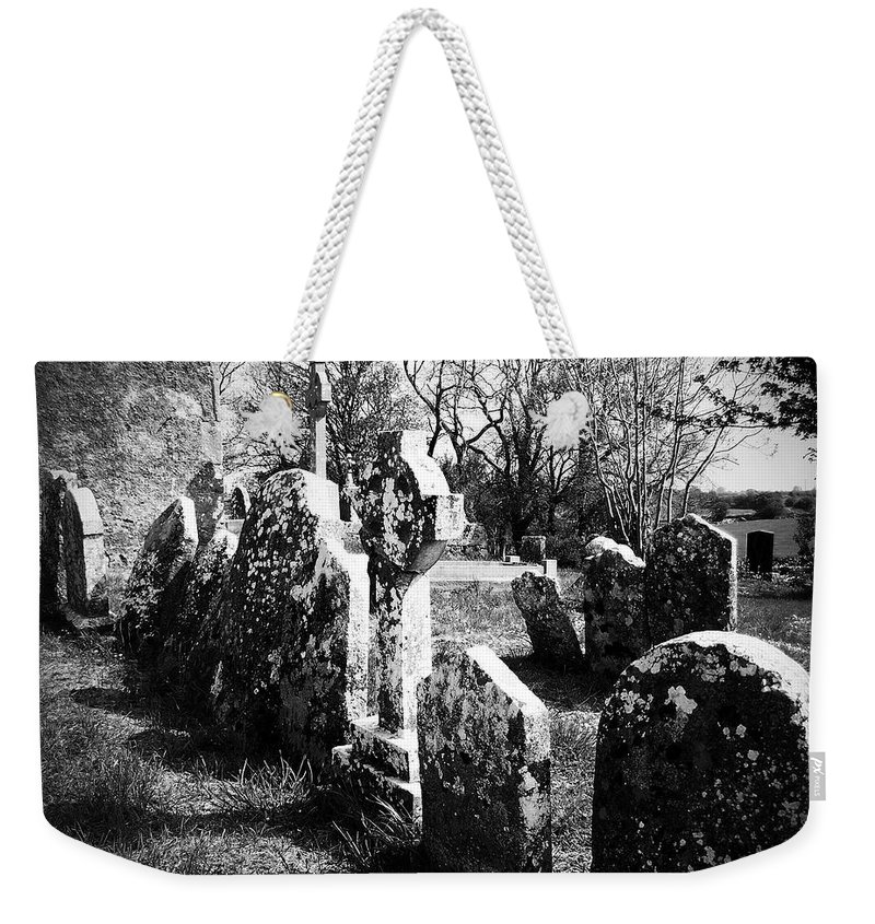 Ireland Weekender Tote Bag featuring the photograph Solitary Cross At Fuerty Cemetery Roscommon Irenand by Teresa Mucha