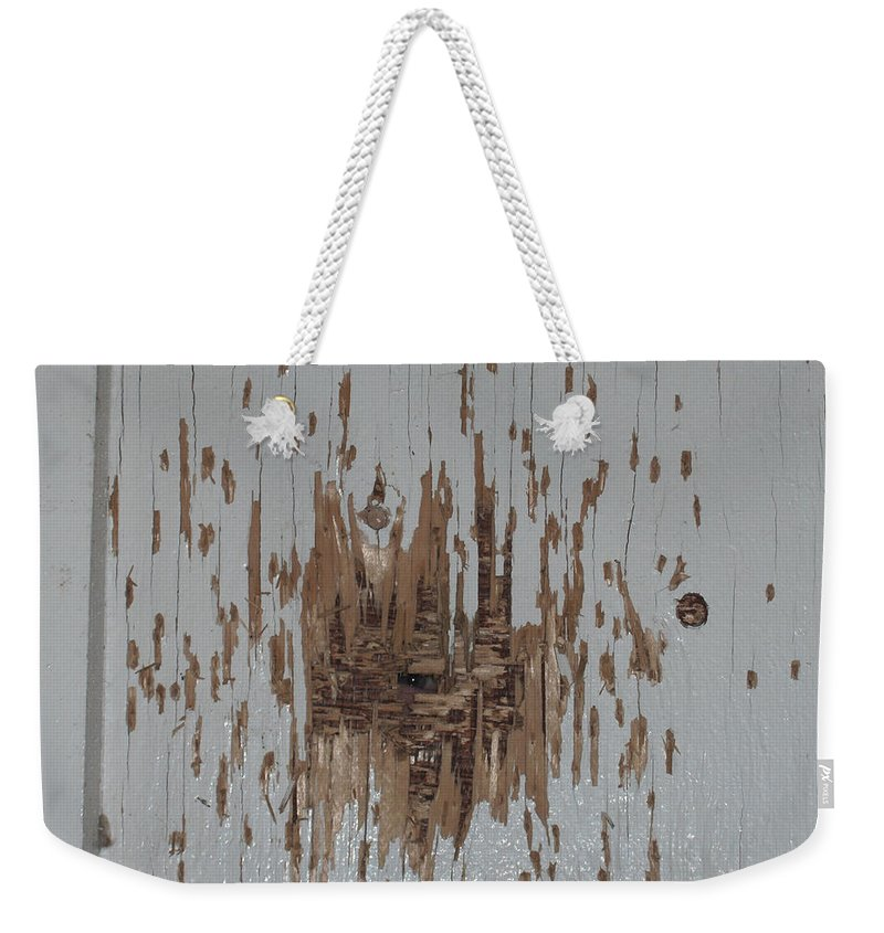 Eye Gun Shot Walls Hole Eerie Scary Wood Alone Weekender Tote Bag featuring the photograph Someone Watching by Andrea Lawrence