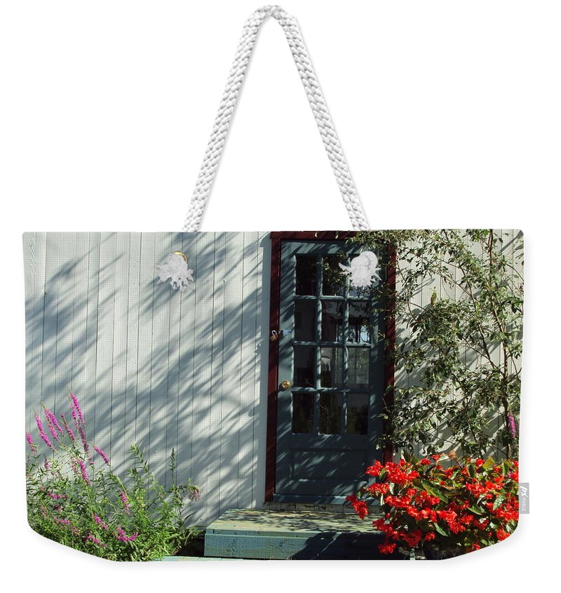 Weekender Tote Bag featuring the photograph Somewhere At St Louis Village by Line Gagne