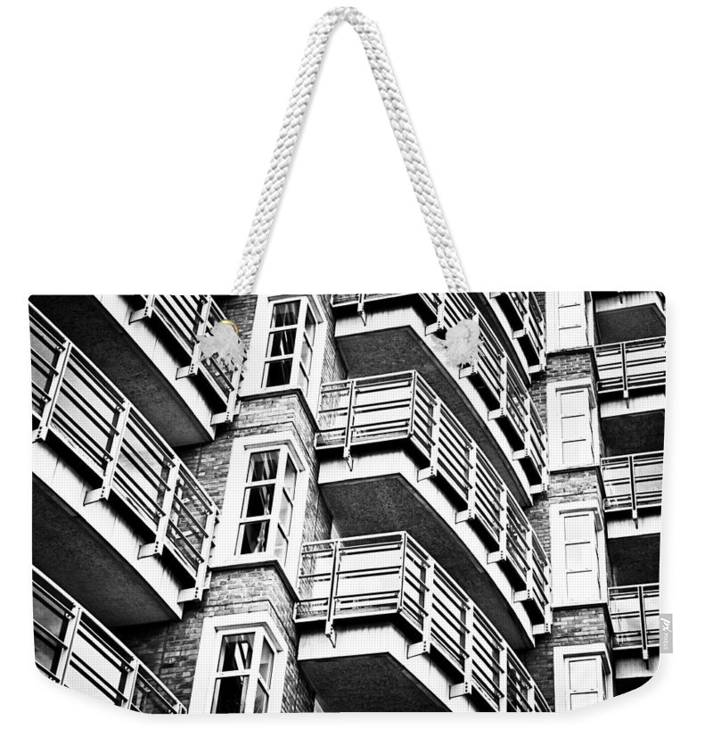 Accommodation Weekender Tote Bag featuring the photograph Somewhere Up There by Tom Gowanlock