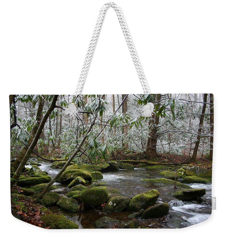 River Stream Creek Water Nature Rock Rocks Tree Trees Winter Snow Peaceful White Green Flowing Flow Weekender Tote Bag featuring the photograph Soothing by Andrei Shliakhau