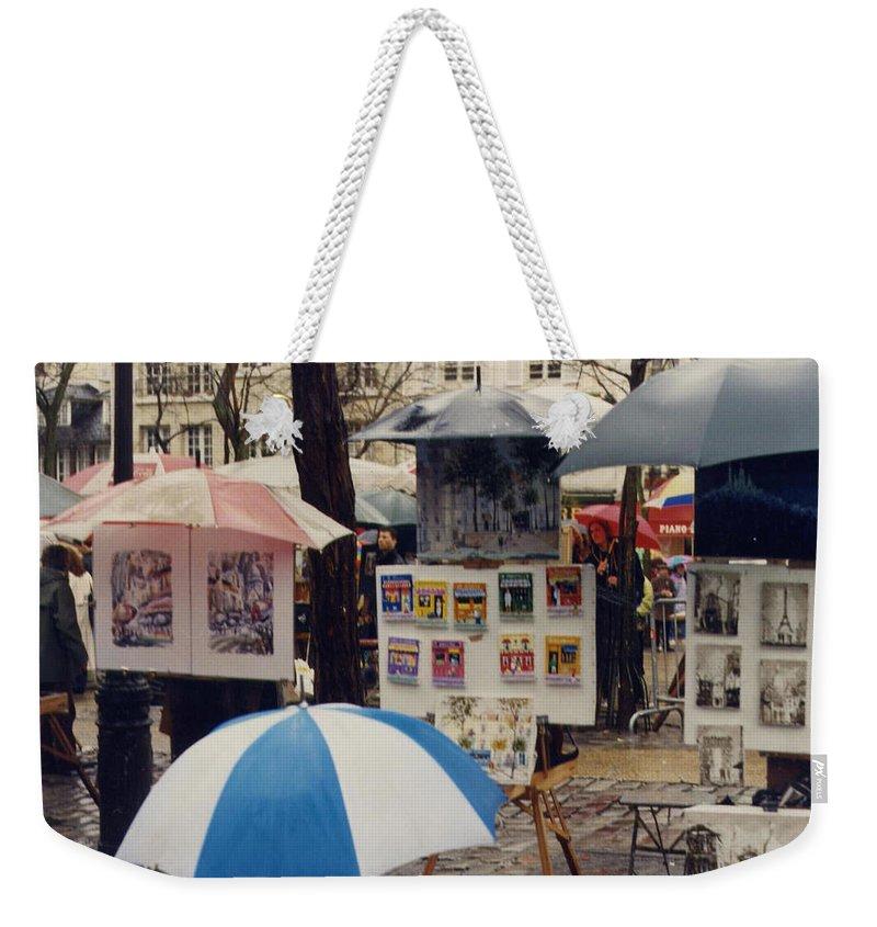 Paris Weekender Tote Bag featuring the photograph Sous La Parapluie by Maria Joy