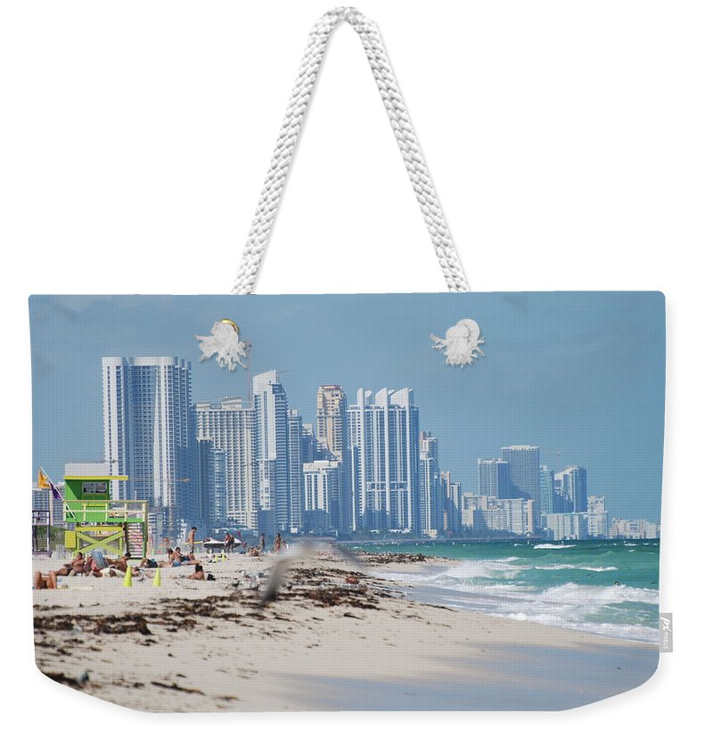 South Beach Weekender Tote Bag featuring the photograph South Beach Baby by Rob Hans