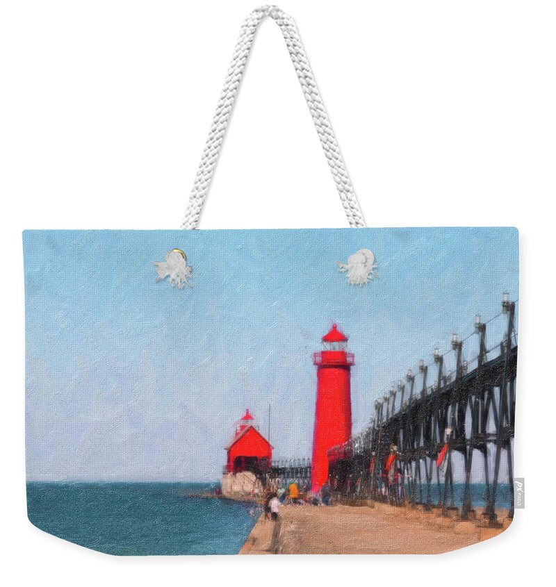 Michigan Weekender Tote Bag featuring the photograph South Pier Of Grand Haven by Tom Mc Nemar