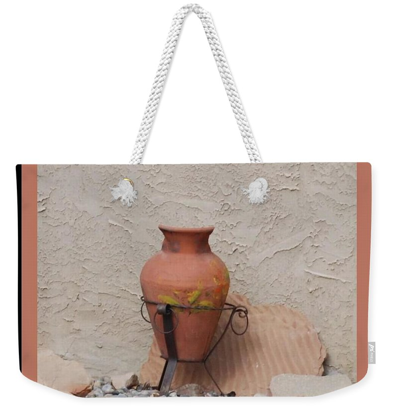 Rocks Weekender Tote Bag featuring the photograph South West Potery by Rob Hans