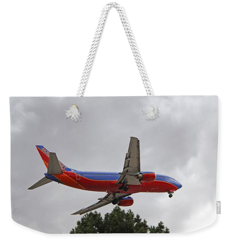 Las Vegas Nv Weekender Tote Bag featuring the photograph Southwest Airlines 737 On Approach Into Las Vegas Nv by Carl Deaville