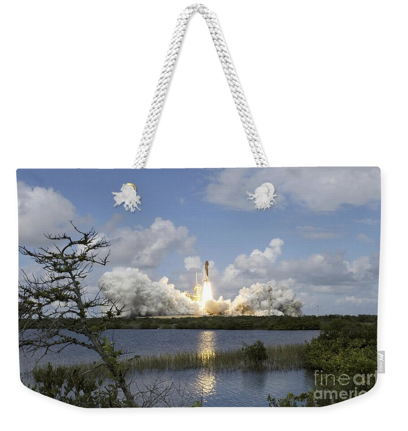 Ascent Weekender Tote Bag featuring the photograph Space Shuttle Discovery Liftoff by Stocktrek Images