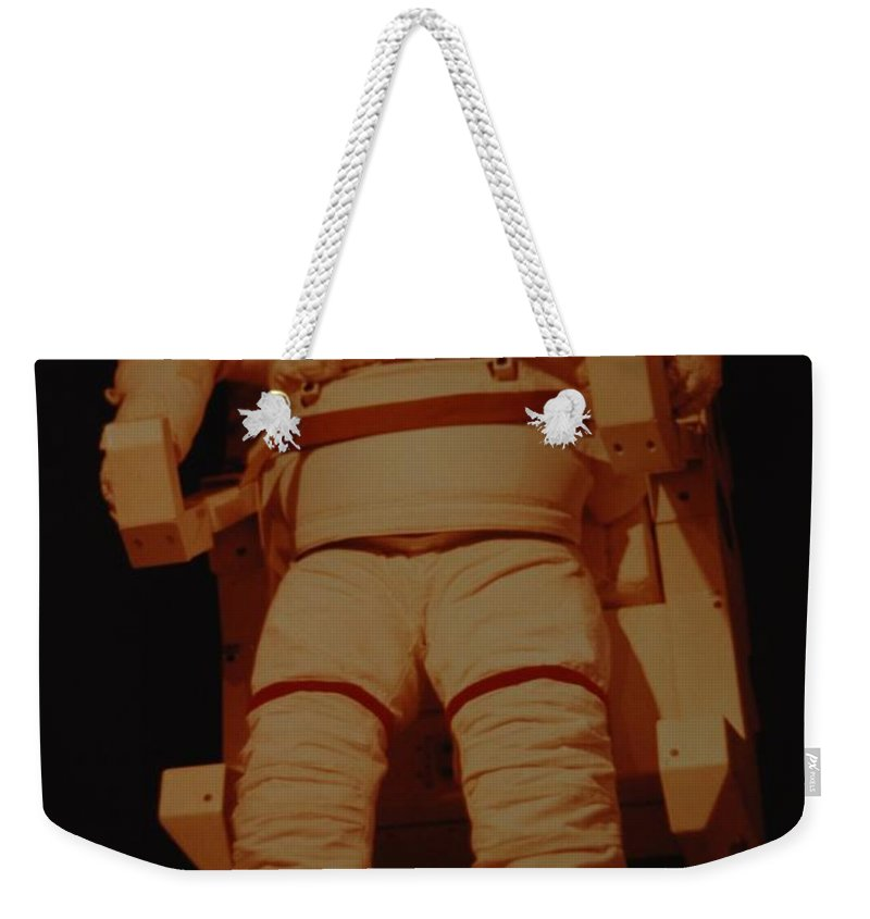 Nasa Weekender Tote Bag featuring the photograph Space Suit by Rob Hans