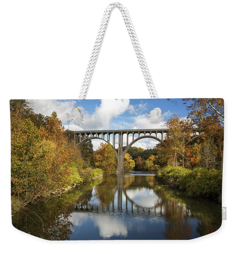 Spanning The Cuyahoga River Weekender Tote Bag featuring the photograph Spanning The Cuyahoga River by Dale Kincaid