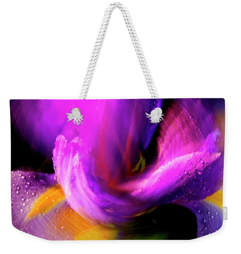 Color Weekender Tote Bag featuring the photograph Spinning Iris by Frederic A Reinecke