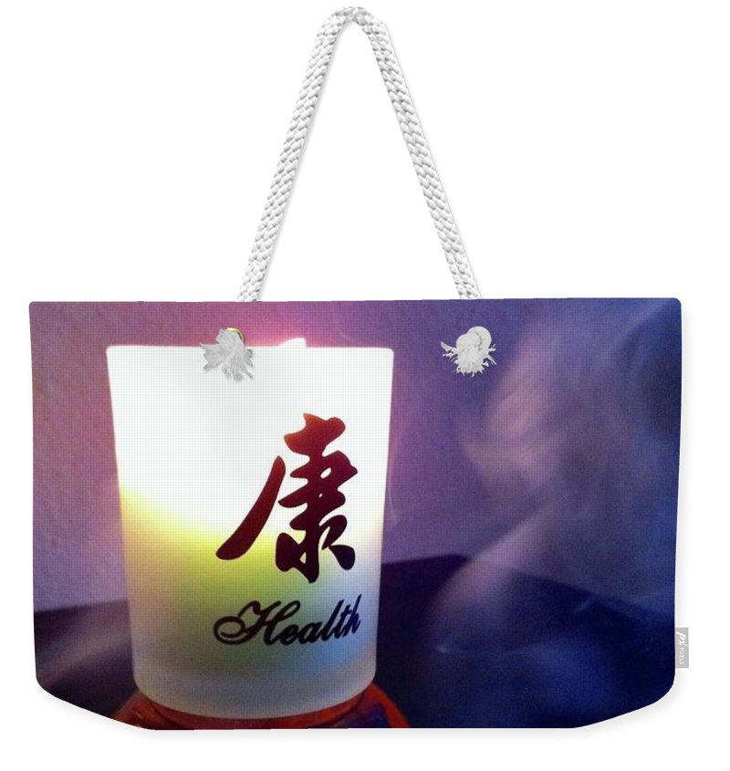 Candle Weekender Tote Bag featuring the photograph Spirit Of Health by Viki Velazquez