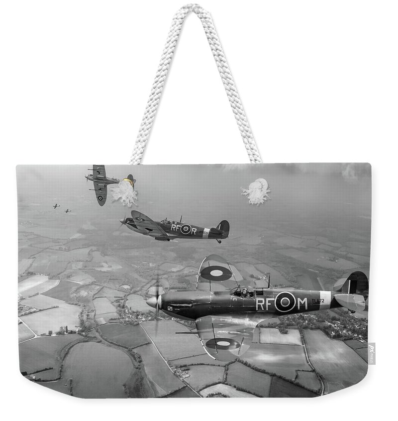 Spitfire Weekender Tote Bag featuring the photograph Spitfire Sweep Black And White Version by Gary Eason