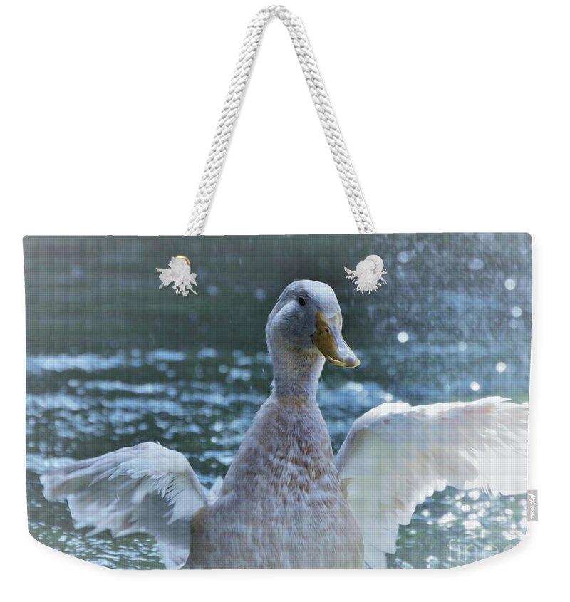 Splashing Duck Weekender Tote Bag featuring the photograph Splashing Duck by Savannah Gibbs