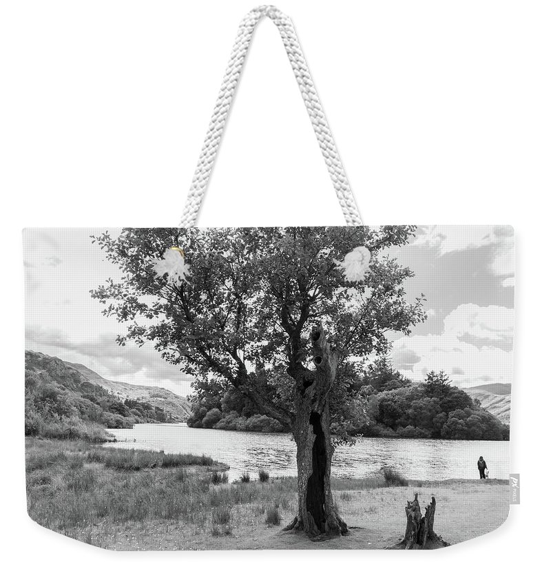 Cumbria Lake District Weekender Tote Bag featuring the photograph Spot The Woman And Her Dog- Behind The Tree by Iordanis Pallikaras