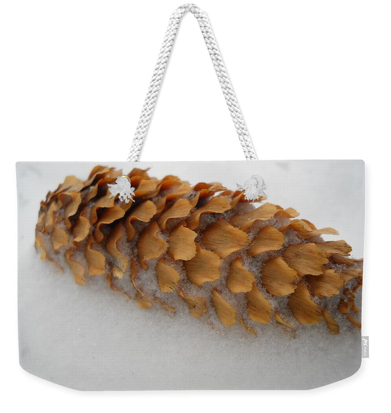 Spruce Tree Cone Weekender Tote Bag featuring the photograph Spruce Tree Cone In The Snow by Kent Lorentzen