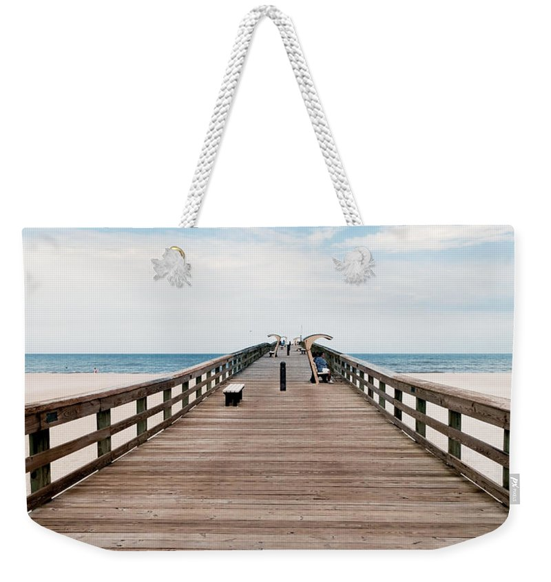 Pier Weekender Tote Bag featuring the photograph St. Augustine Pier by Rachel Morrison