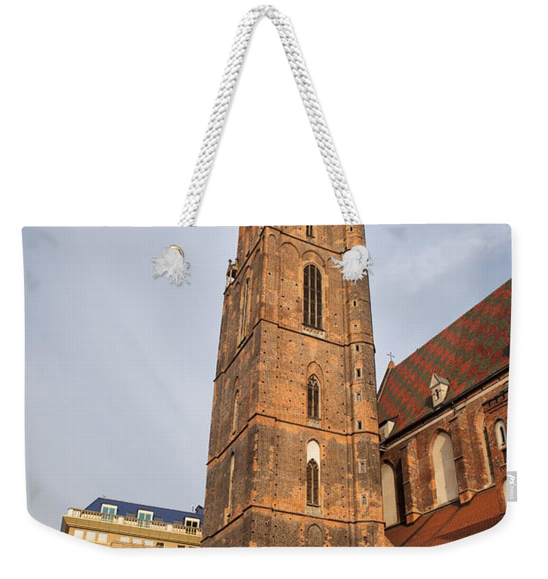 Wroclaw Weekender Tote Bag featuring the photograph St. Elizabeth's Church Tower In Wroclaw by Artur Bogacki