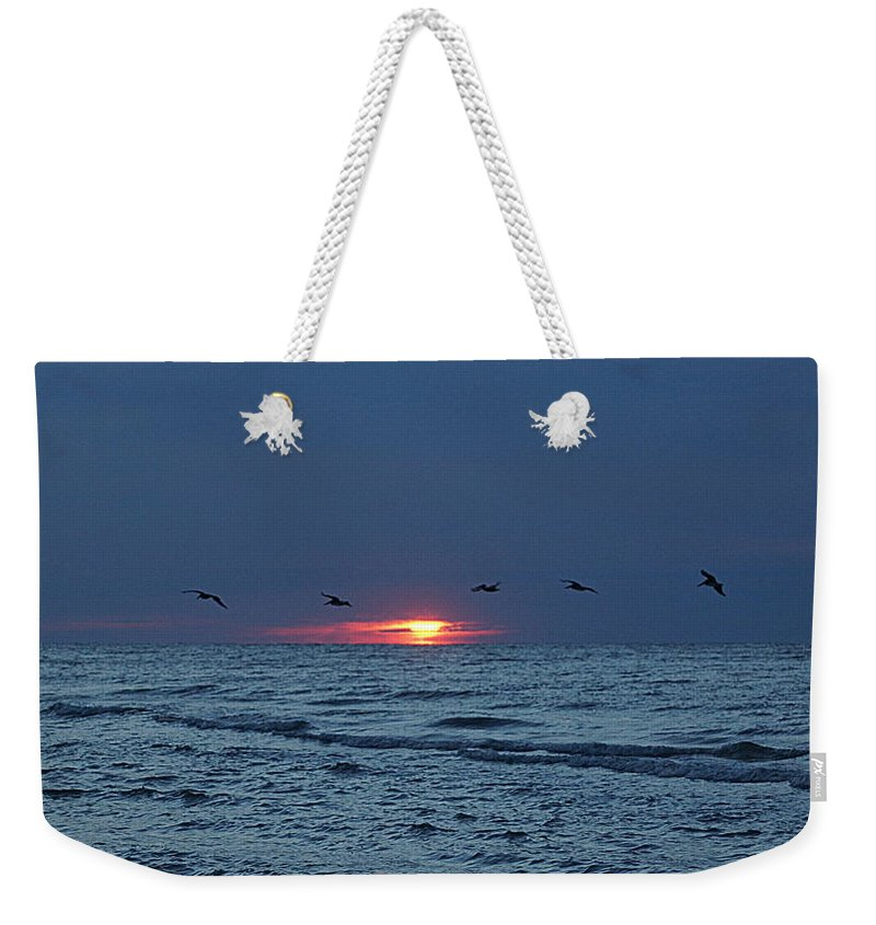 Sunrise Weekender Tote Bag featuring the photograph St. George Island Sunrise by Paul Wilford