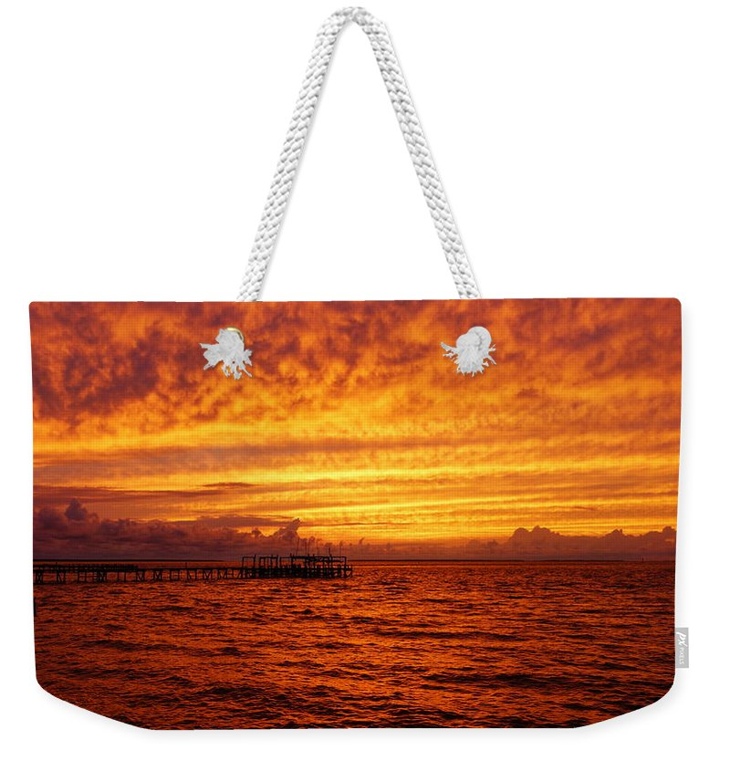 Sunset Weekender Tote Bag featuring the photograph St. George Island Sunset by Paul Wilford