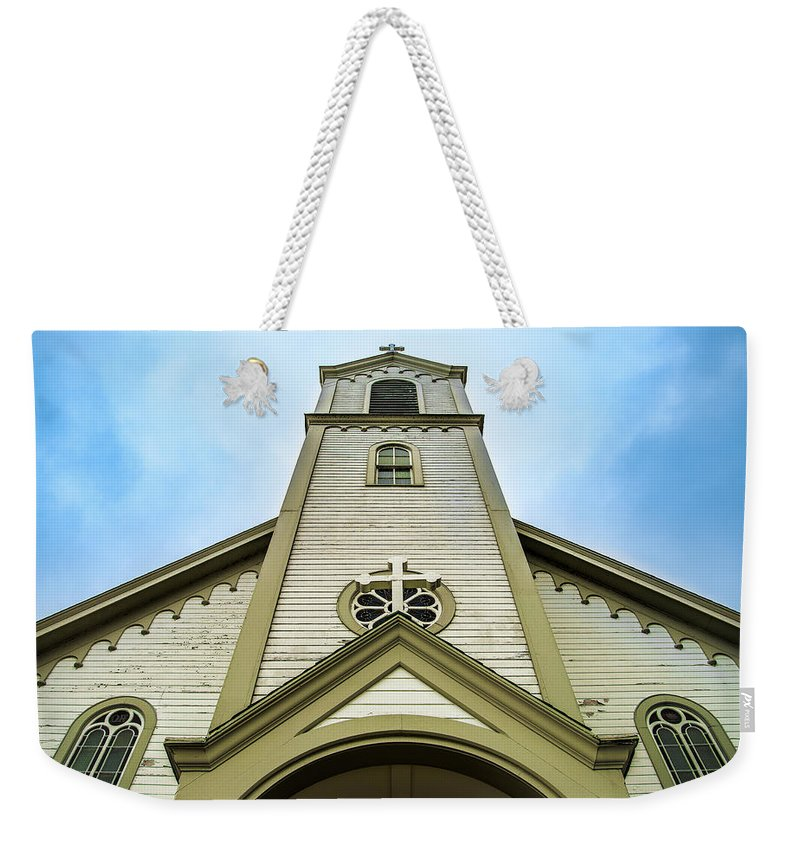 Odawa Weekender Tote Bag featuring the photograph St. Ignatius Of Loyola Church And Cemetary by Onyonet Photo Studios