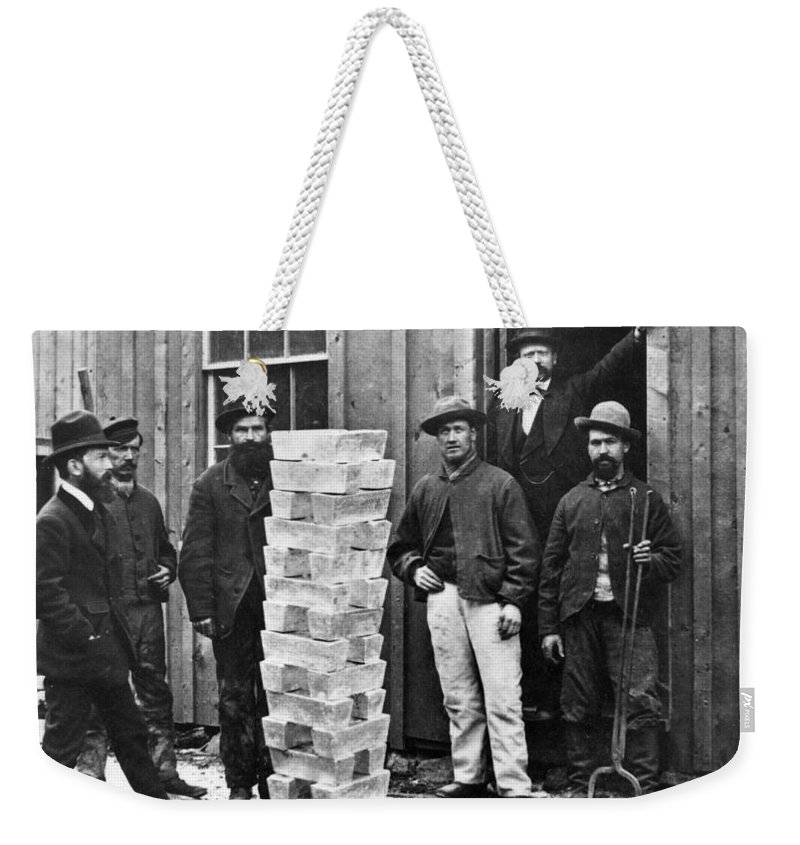 1880 Weekender Tote Bag featuring the photograph Stack Of Silver Ingots by Granger