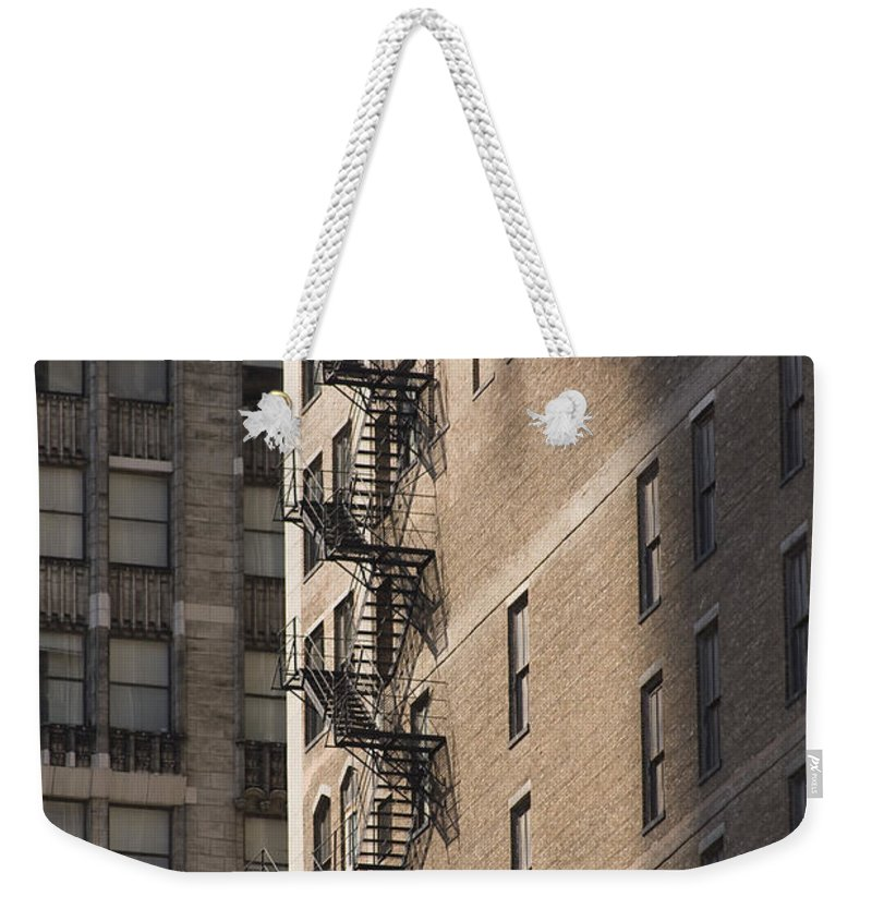Chicago Windy City Metro Urban Building Stairs Windows Light Shaddow Weekender Tote Bag featuring the photograph Stairs by Andrei Shliakhau